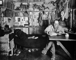 Scott writing his journal in the Cape Evans hut, winter 1911