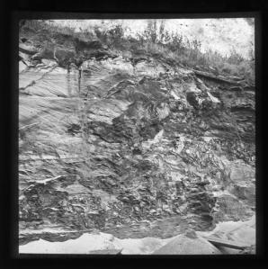 LDGSL/1088/JB/1 Black and white photograph showing a geological feature from Oxted, Surrey, by Johnson, Bird and Co, [1890s-1900s].   Partial caption 'Iron...?'