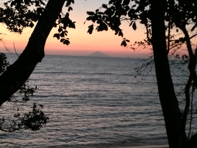 Sunset across Sunda Straits, with Anak Krakatau in distance.
