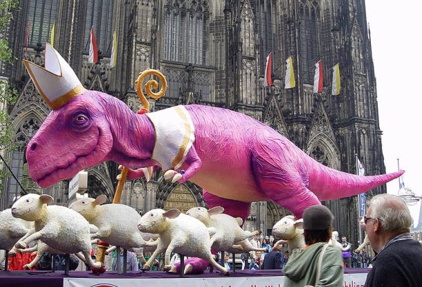 A sculpture of a dinosaur and sheeps (10 meters long and 4 meters tall) as criticism of the church/pope/WJT