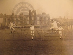 F Teall competing in the 120 yard hurdles, 1903