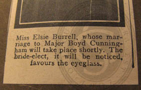 Bottom part of newspaper cutting showing Elsie Burrell wearing a monocle, 1916