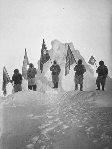 Robert Peary and sledge party with flags at North Pole. Peary has been claimed to be the first person to reach the north pole.