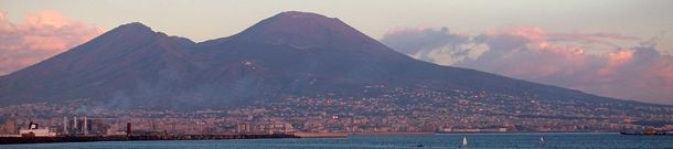 Mt Vesuvius in the distance with the densely populated Naples in the Foreground. Image Credit - Antonsusi, Wikimedia Commons.