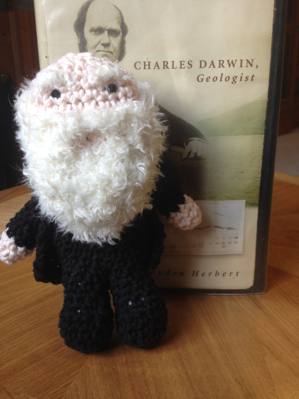 Darwin peruses his biography