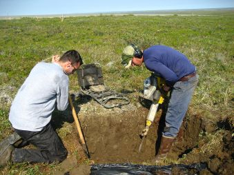 1280px-Digging_in_permafrost