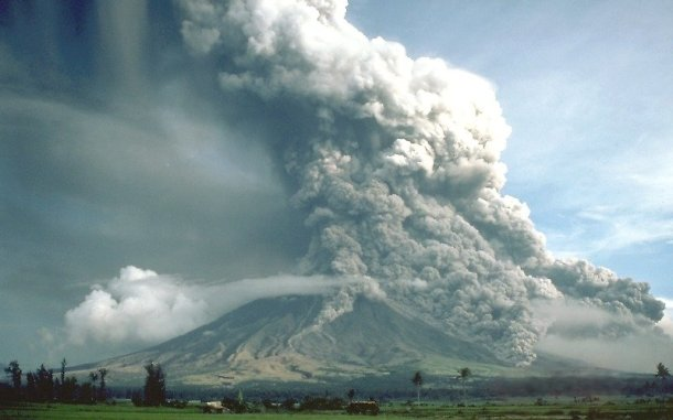 Pyroclastic flows sweep down the flanks of Mayon Volcano, Philippines, in 1984 (Wikipedia)