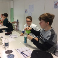 Creating CO2 with vinegar and bicarbonate of soda to blow up a balloon.